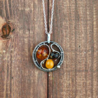 amber necklace on wood