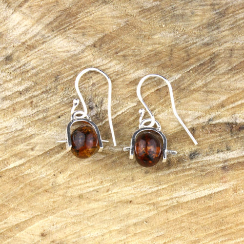 amber earrings laying down